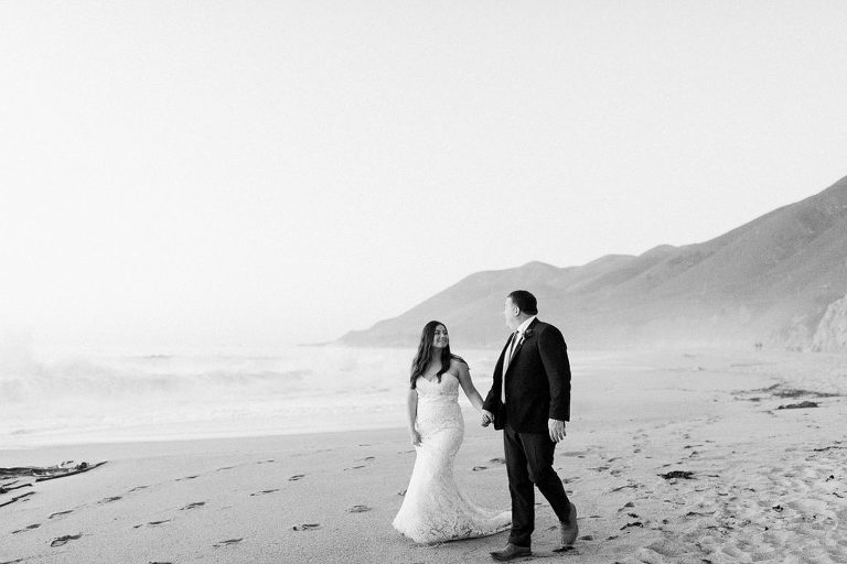 Couple walking on the beach in Big Sur