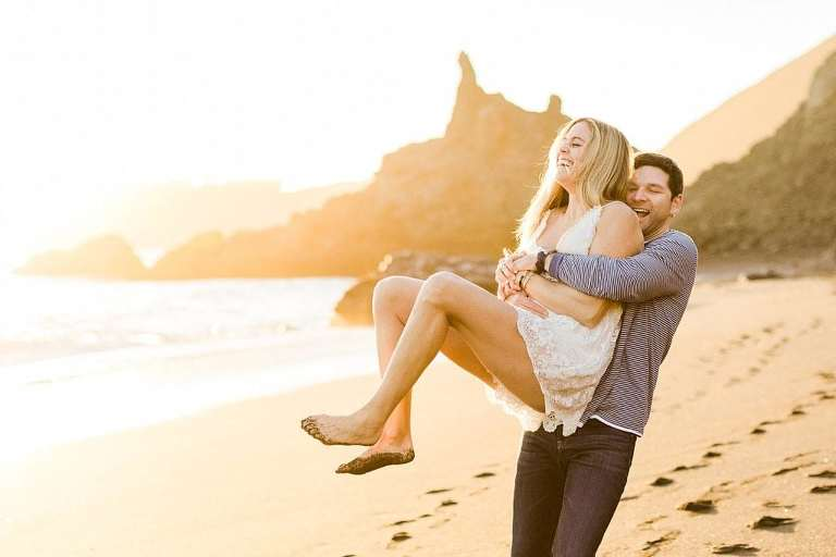 Couple having fun on beach that is one of the best places to elope in California