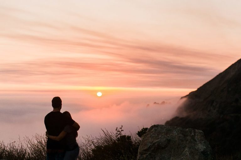 Couple watching a sunset in Big Sur