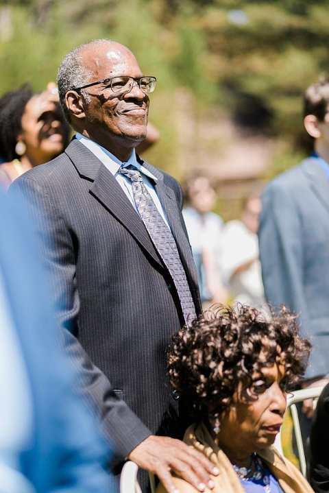 Proud grandpa at wedding ceremony