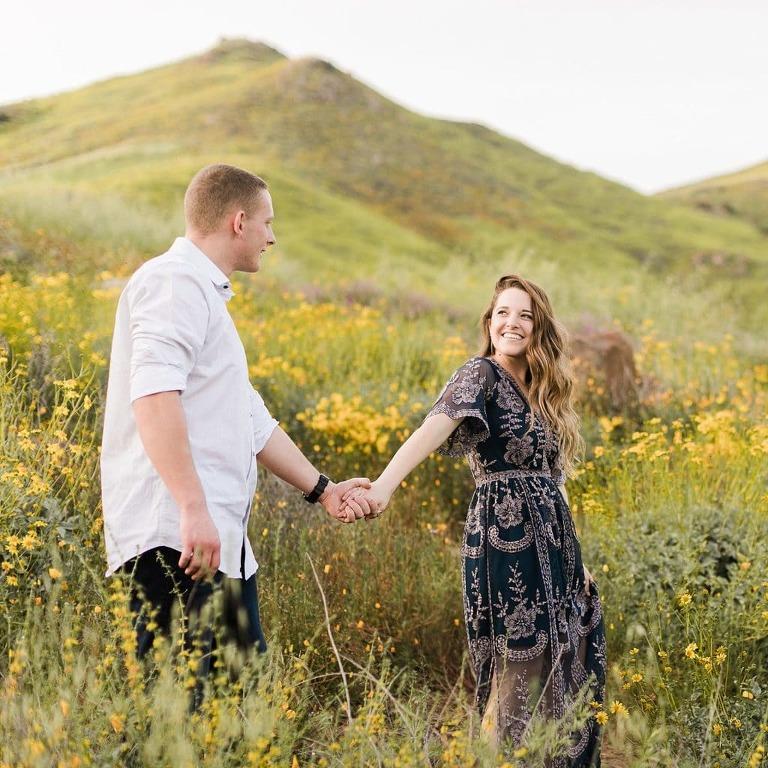 Couple walking in wildflower field in Lake Elsinore