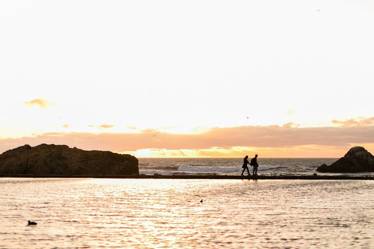 Elopement couple walking at Sutro Baths in San Francisco