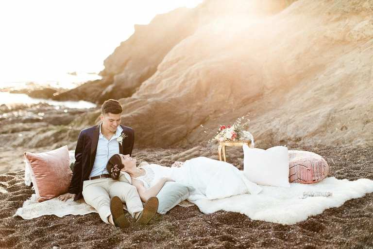Boho Rodeo Beach elopement couple laying on the beach