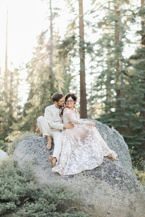 elopement couple sitting on a rock in one of the most gorgeous places to elope in California, Yosemite National Park