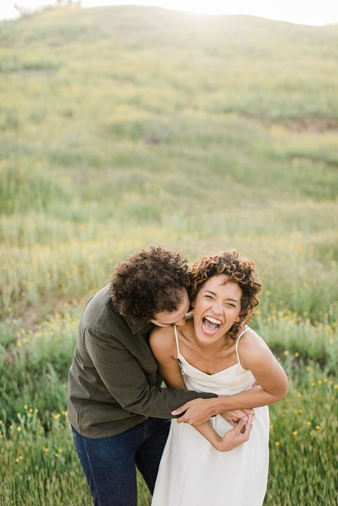 elopement couple in Carrizo Plain National Monument with yellow wildflowers